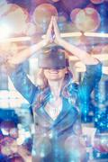Happy businesswoman with hands joined using virtual reality simulator in offi Stock Photos