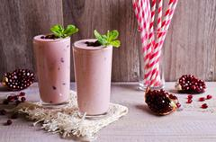 Smoothies pink in a glass Stock Photos