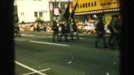 1968: military parade marching in formation down a street  Stock Footage