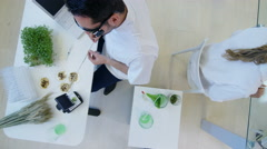 4K Overhead view of scientific research team analyzing food & plant samples Stock Footage