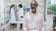 4K Portrait of smiling mature man at the pharmacy Stock Footage