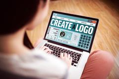 Webpage for create a logo against asian woman using laptop with copy space Stock Photos
