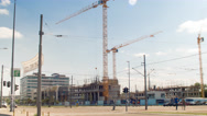 Construction site, crossroads. Cranes and cars. People crossing the road. Stock Footage