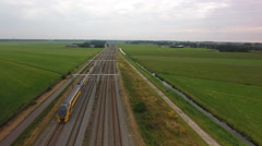Train in Dutch landscape. Aerial perspective. Stock Footage
