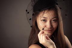 Charming Korean teenager girl with veiled face Stock Photos