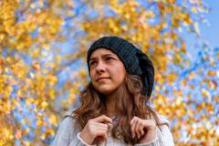 Beautiful elegant Girl standing in a park in autumn Stock Photos