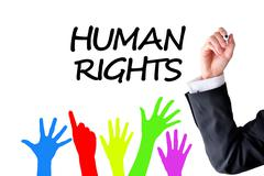 Human rights lawyer writing on white background Stock Photos