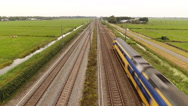 Train passing underneath rising camera, Holland. Stock Footage