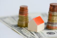 House property prices concept with money pillars from coins Stock Photos