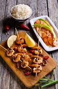 Cooked shrimp on skewers Stock Photos