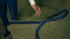 Handsome businessman preparing to official event, straighten tie. New job Stock Footage