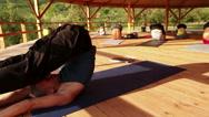Yoga trainer conducts a seminar performing asana Stock Footage