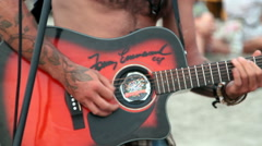 Man playing music on the beach. Stock Footage