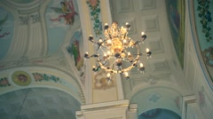 Detail of of the Orthodox Church. Bright dome and chandelier Stock Footage