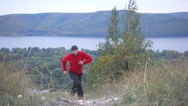 Running man trail runner in cross-country training run. Male athlete sports r Stock Footage