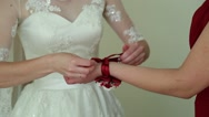 Bridesmaid is helping the bride to dress Stock Footage
