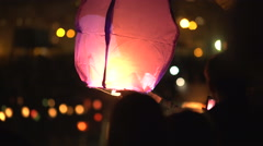 Running the air lantern into the sky. Romantic. Red air flashlight Stock Footage