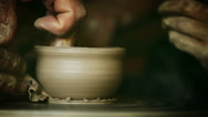 Potter's wheel real-time footage: a process of making of clay bowl Stock Footage