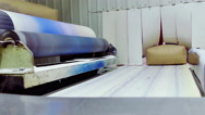 Packing Sugar on a Conveyor Belt in a Factory for Processing Sugar Beet Stock Footage