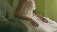 The beautiful amusing bride in a white dress sits on a brown background Stock Footage