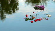 Bouquets of carnations and lilacs floating on the water Stock Footage