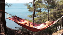 Beautiful young girl resting in a hammock Stock Footage