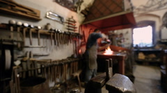Interior of the forge and master at work Stock Footage
