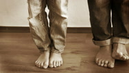 Mother and son step on each other's feet as a prank Stock Footage