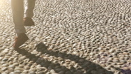 Merry man hops walking by the cobbled street Stock Footage