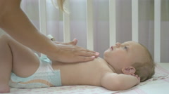 The woman rubs cream into belly baby. Stock Footage