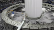Textile industry - yarn spools on spinning machine in a factory Stock Footage
