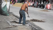Construction workers in the pavement construction, excavation pit Stock Footage