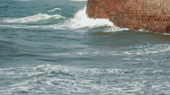 Waves strike the stone wall Stock Footage
