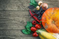 Fresh vegetables on a dark table. Autumn background. Healthy eating. Pumpkin Stock Photos