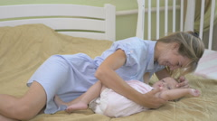 Young mother breastfeeding her little daughter. Stock Footage