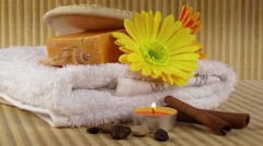 Spa Concept with flowers,towel,soaps and candle on rotating bamboo background Stock Footage