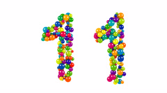 Bright colored balls in the shape of number eleven Stock Footage