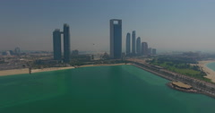 Abu Dhabi from Lulu island helicopter fly through Stock Footage