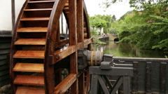 Close up on watermill and slide to background with rack-focus Stock Footage