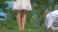 Baby crawls to the mother's foot on the grass. Stock Footage