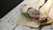 Man's hand cut steak meat dish Stock Footage