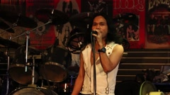 Singer sings the song at the Hot Tuna bar on a Walking Street. Pattaya, Thailand Stock Footage