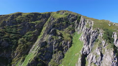 Aerial footage of a summit in Grisons in the alps in Switzerland, 4K, UHD Stock Footage