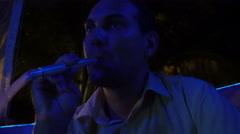 Young caucasian man smoking hookah Stock Footage