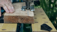 Man sawn a wooden board with an electric jigsaw. Stock Footage