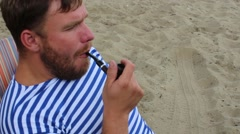 Sailor smoking a pipe, sitting near the water Stock Footage