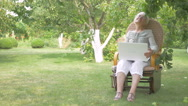 Elderly woman sitting in a rocking chair. Stock Footage