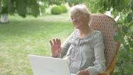 Woman waving in laptop camera. Stock Footage