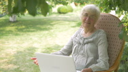 An elderly woman showing thumbs up to the camera. Stock Footage