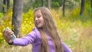 Girl taking self portrait Stock Footage